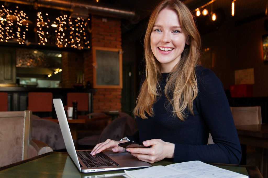 Woman at laptop smiling | Online Mindfulness Training Course | Business Minded